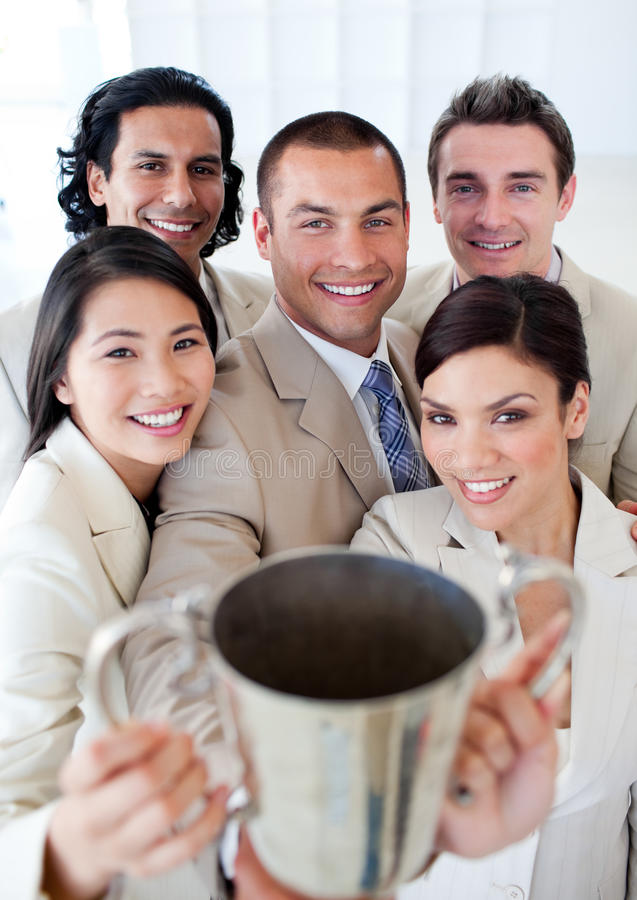 Victorious business team showing their trophy stock photography