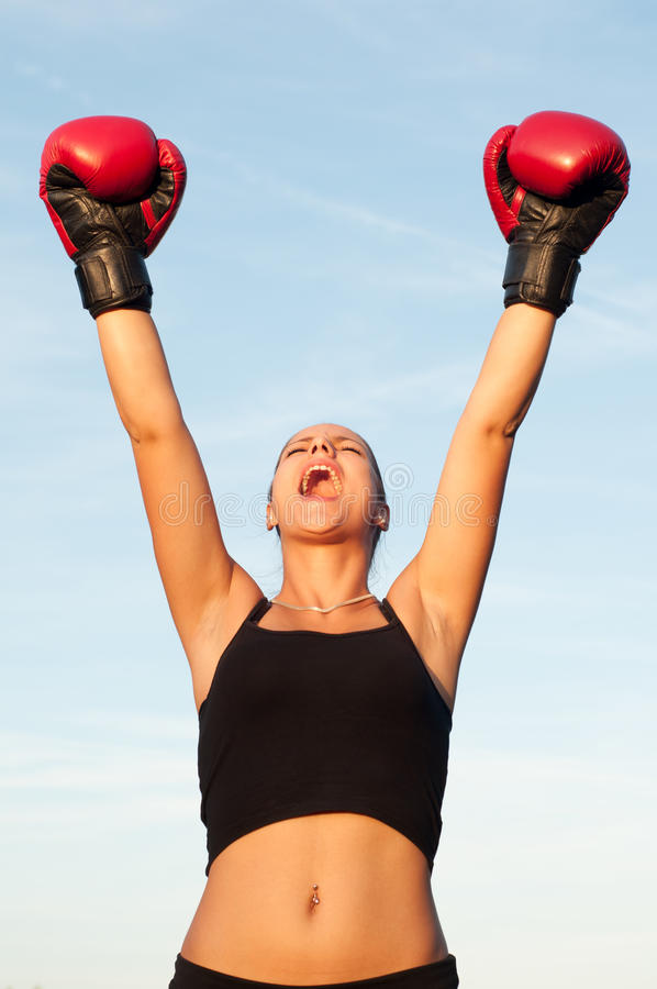 Victorious sports woman in red gloves