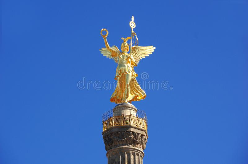 The Victory column Siegessauele in Berlin - Germany. The Victory column Siegessauele in Berlin with the golden statue of ancient greco-roman goddess Nike on top royalty free stock photography