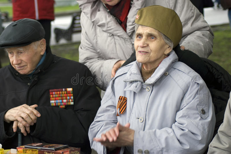 Victory Day celebration in Moscow. War veterans man and woman. MOSCOW - MAY 09, 2017: War veterans man and woman. Victory Day celebration in Moscow, in Gorky stock images