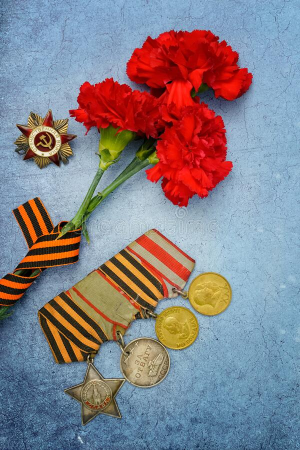 Free Victory Day.Order Of The Red Star With The Russian Inscription Patriotic War And Medals On A Blue Background With Red Carnations. Stock Image - 214950021