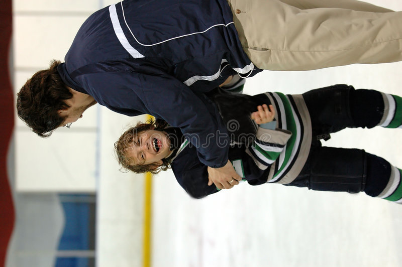 Download Victory embrace with coach stock photo. Image of embrace - 1168612