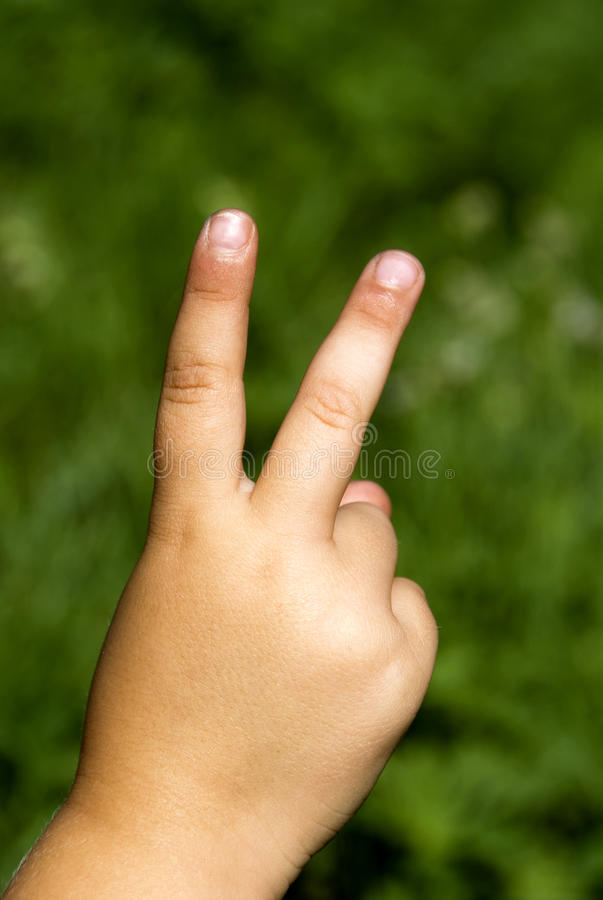 Victory hand sign stock photography