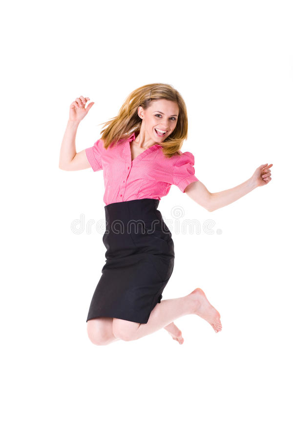 Victory jump, attractive businesswoman in shirt. Attractive businesswoman in pink shirt and bare foot jump up, happines and victory concept, studio shoot stock image