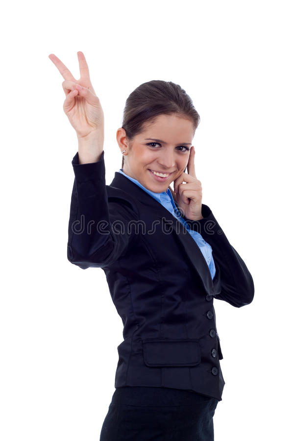 Victory on the phone. Happy business woman with phone and victory gesture, isolated stock photography