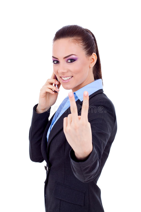 Victory on the phone. Happy business woman with phone and victory gesture, isolated stock photos