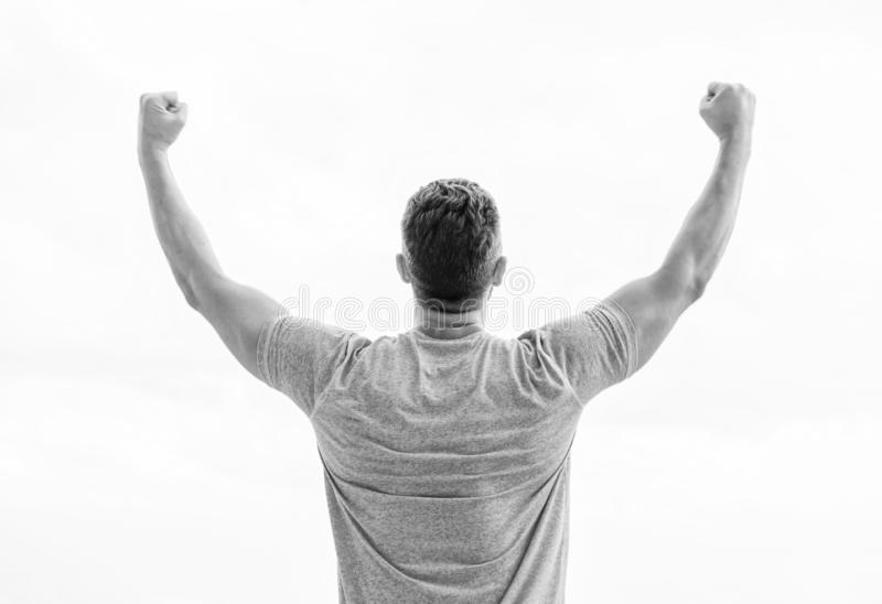 Victory and success. Champion winner. Future opportunity. Leadership and competition. Future concept. Looking forward in. Future. Strong muscular body feeling royalty free stock image