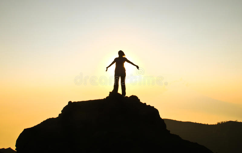 Victory. A woman celebrating victory on top of volcano Pacaya during sunset, Guatemala royalty free stock photo