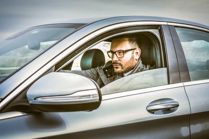 A vida empresarial é mais fácil com o carro fotos de stock royalty free