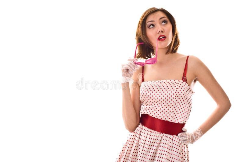 Vida en vidrios rosados. Mujer joven divertida fotos de archivo libres de regalías