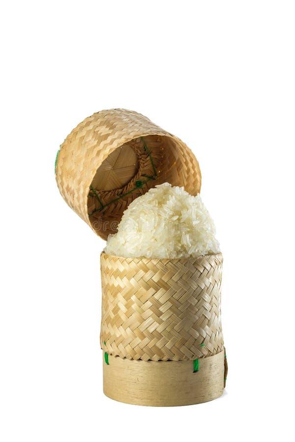 Vide- hemslöjd för tradition för klibbiga ris för bambu med vit backgr arkivbilder