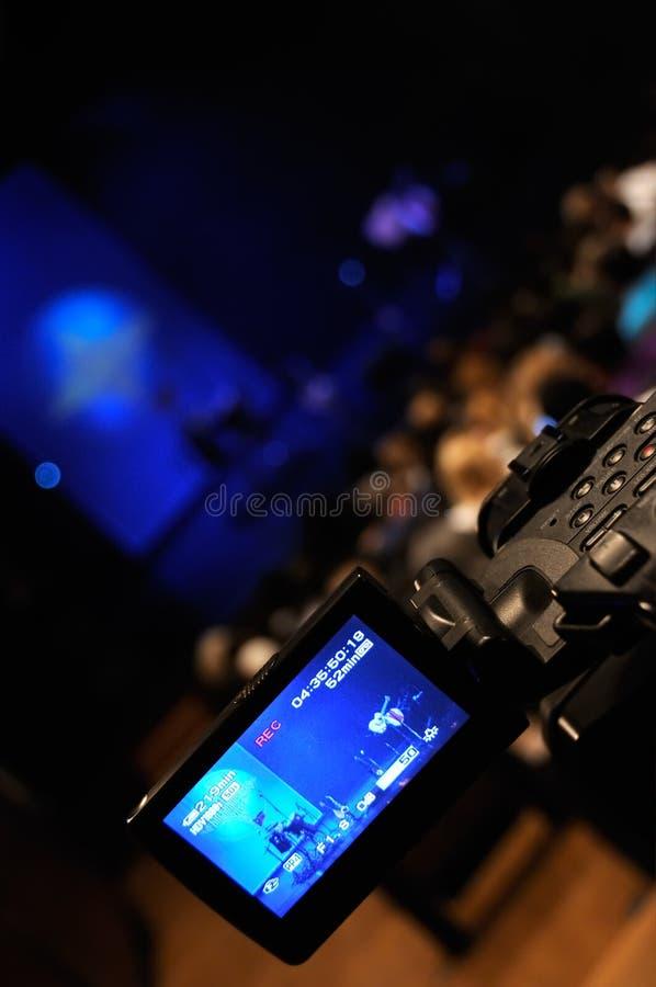 Video camera. Digital video camera shooting a rock concert