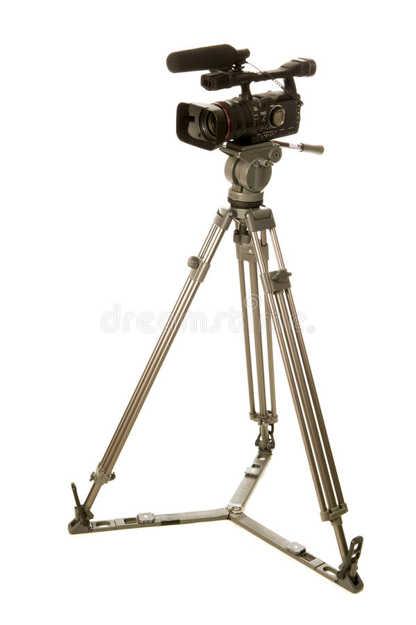Video camera. Professional video camera in tripod on white background royalty free stock image