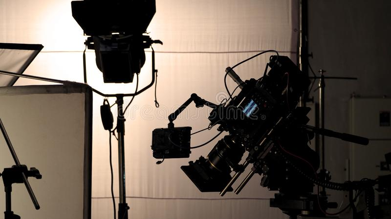 Video camera in film or movie production on tripod. And professional gear which shooting in location or studio with crew team and beautiful prop or set and stock photos