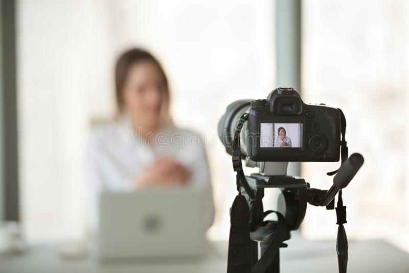 Video camera filming live training of successful business coach royalty free stock photography