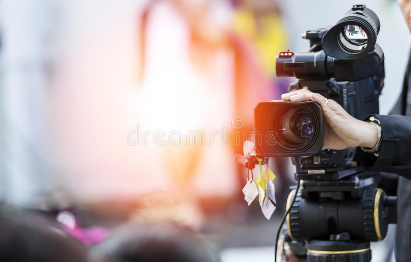 Video camera operator stock photos