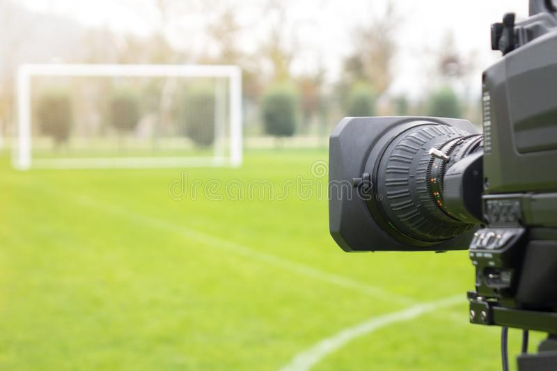 Video camera put on the back of football goal for broadcast on TV sport channel. football program can `t editing in studio. Camera man is importance to catch royalty free stock image