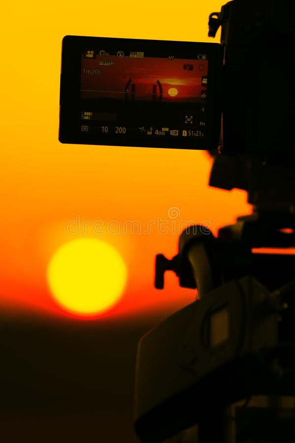 Video camera recording an amazing sunset royalty free stock images
