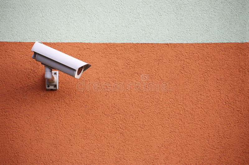 Video camera security system. On the wall of the building royalty free stock image