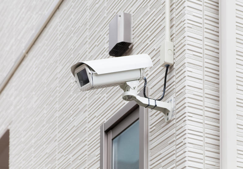 Video camera security system on the wall. Of the building royalty free stock image