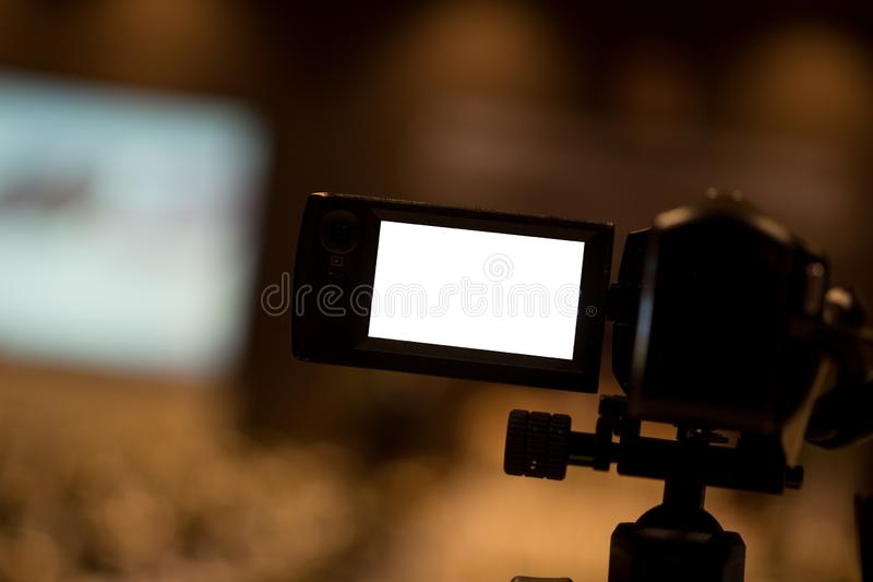Video camera set record audience in conference hall seminar event stock photography