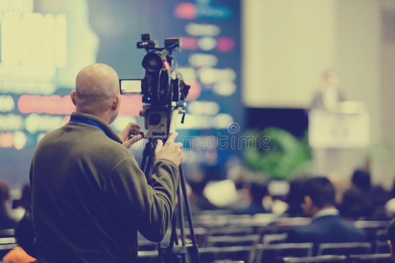 Video camera set record speaker and audience in conference hall seminar event stock photos