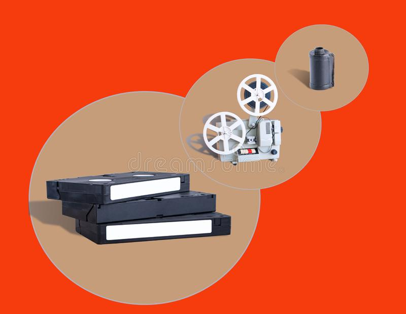 Video cassettes, film projectors and film cassettes stock photo