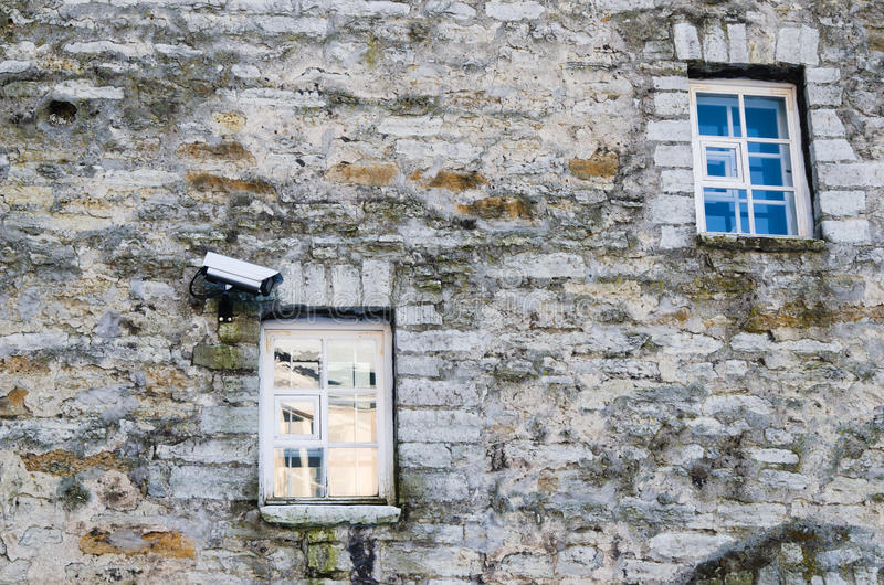 Video the chamber on a building facade. The chamber of video observation on a wall of a building near a window royalty free stock images