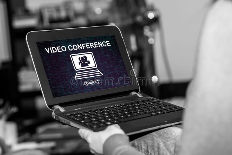 Video conference concept on a tablet. Tablet screen displaying a video conference concept stock photography