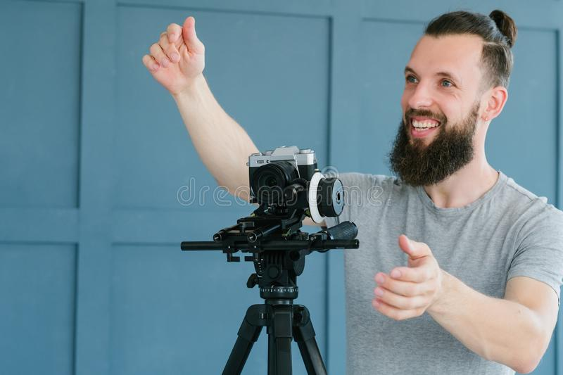Video content shooting cameraman instruction work. Video content creation process. cameraman shooting footage for vlog broadcast or report and giving stock photo