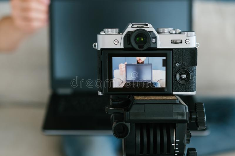 Video creation image man camera screen footage. Video content creation process. image of a man on a camera screen. shooting footage for blog concept royalty free stock photos