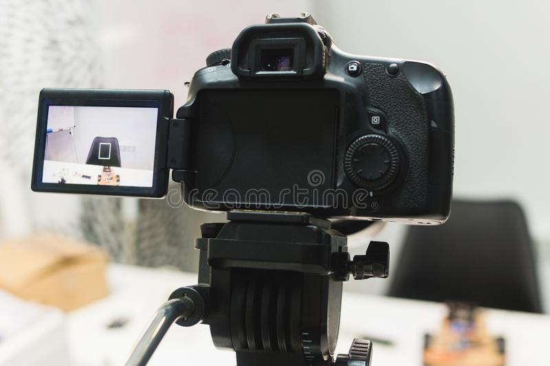 Video creation process backstage concept. Before recording a video blog. angle selection. preparation of the location. modern equipment concept royalty free stock image