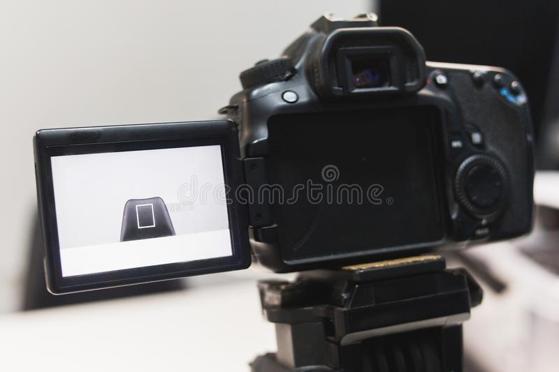Video creation process backstage concept. Before recording a video blog. angle selection. preparation of the location. modern equipment concept royalty free stock photo