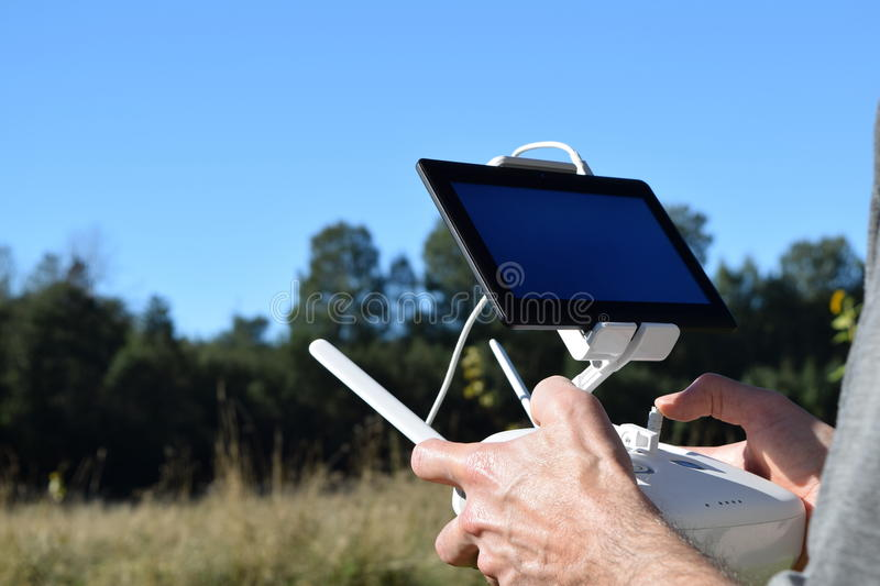 Technology Media Video Aerial Imaging Multicopter Pilot Holding R/C Transmitter Shooting Images - Video Drone. Close-up of attractive hands of pilot-in-command royalty free stock image