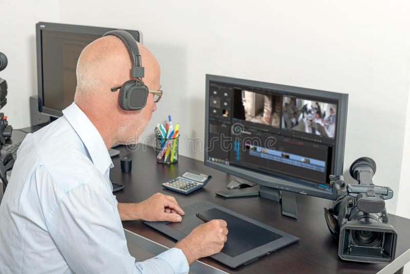 Download Video editor in his studio stock photo. Image of computer - 71642478