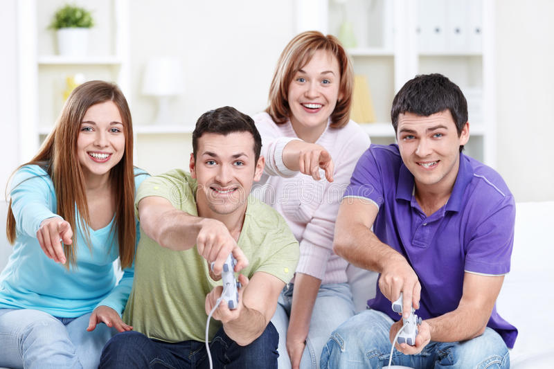 Video Games. Attractive friends play video games royalty free stock images