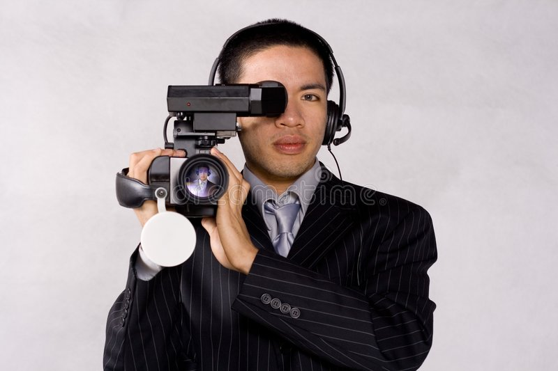 Video high definition. Cameraman using a high definition video camera royalty free stock photos