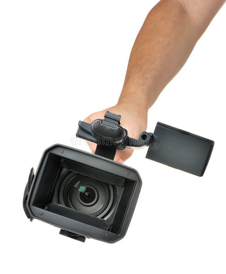 Video Kamera in einer Hand lizenzfreies stockbild