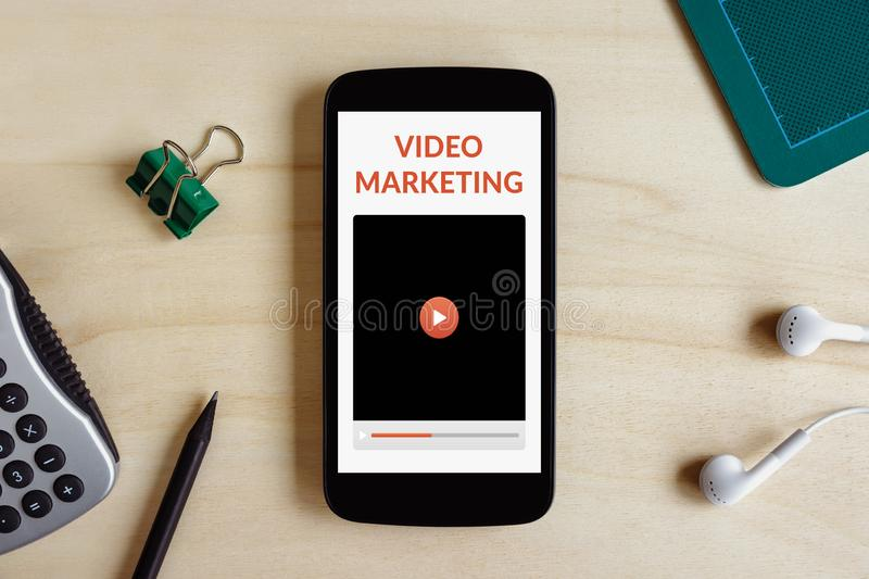 Video marketing concept on smart phone screen royalty free stock image