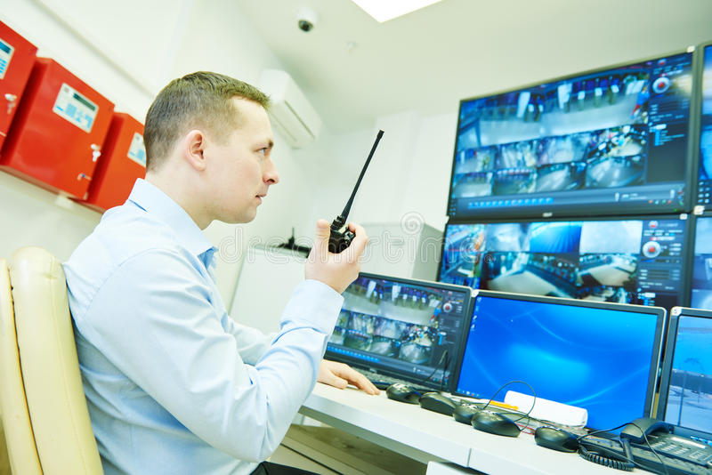 Video monitoring surveillance security system. Security guard officer watching video monitoring surveillance security system stock photos
