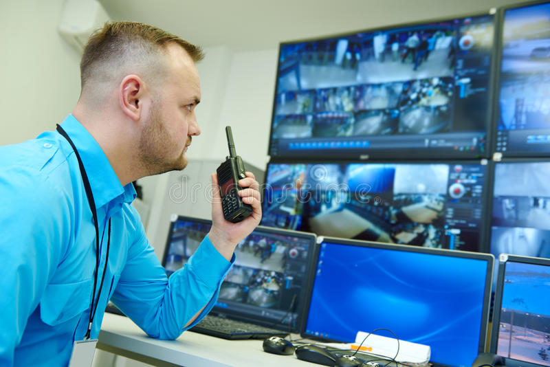 Video monitoring surveillance security system. Security guard officer watching video monitoring surveillance security system royalty free stock images