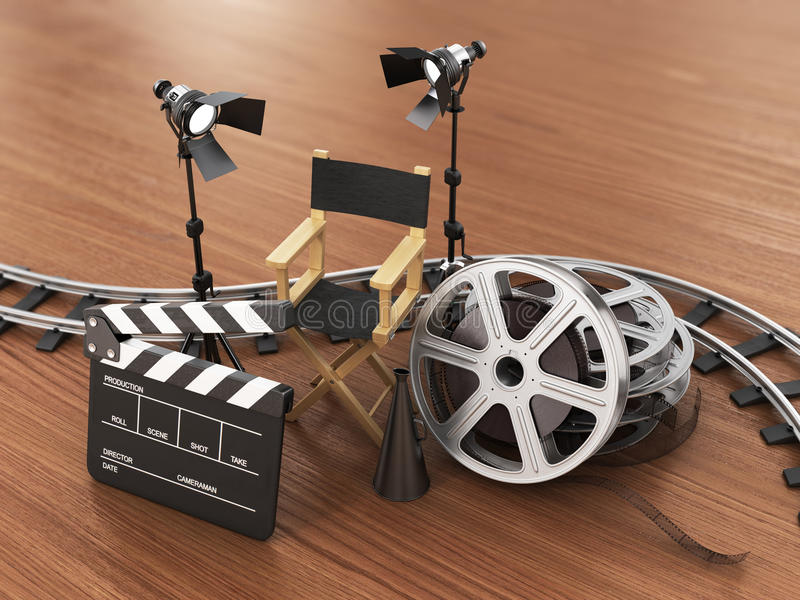 Video, movie, cinema concept. Light, film strip, reels, rails, clapperboard and director chair on the wood background royalty free illustration