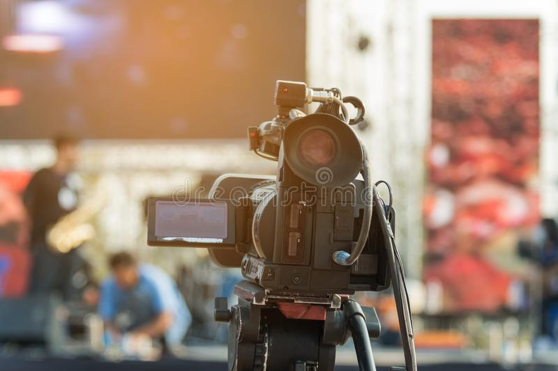 Video production covering event on stage by professional video camera in outdoor concert stock photo