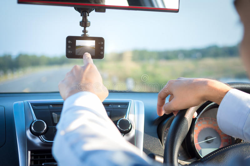 Video recorder driving. A car on highway stock photography