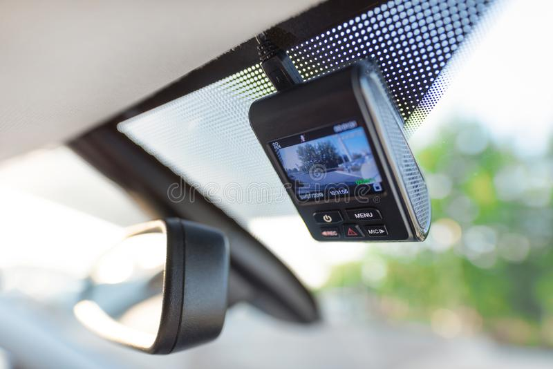 Video recorder next to a rear view mirror royalty free stock photos
