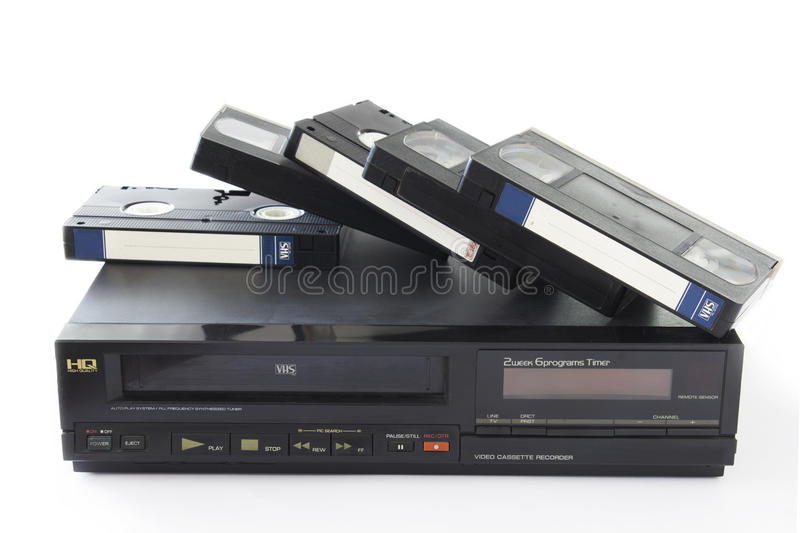 Video Recorder. Old VHS Video Cassettes on Old Video Recorder Isolated on White Background royalty free stock images