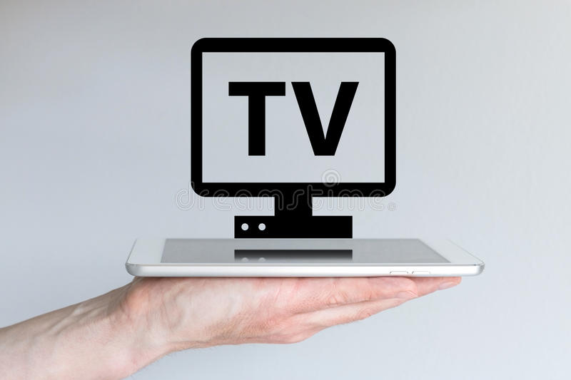 Video streaming and internet TV concept with smart phone or tablet. royalty free stock photos