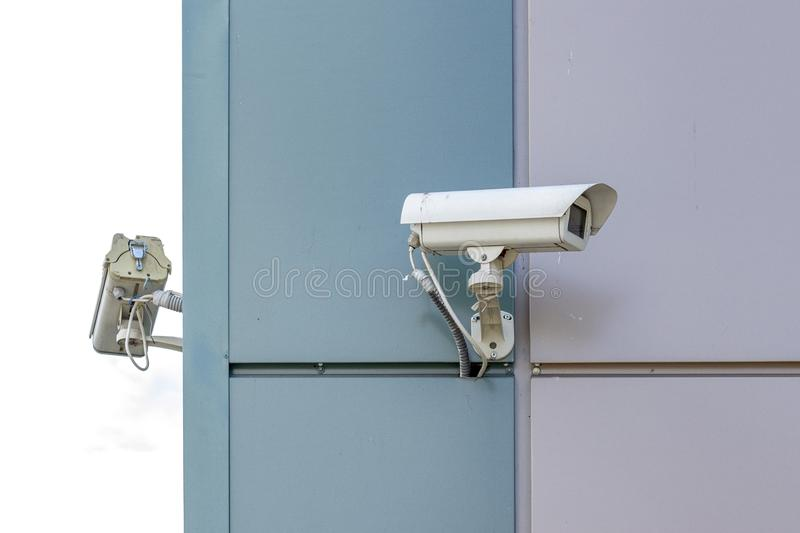 Video surveillance cameras at the end of the building. Two video surveillance cameras at the end of the building royalty free stock photography