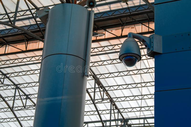 Video surveillance system at the station. Protected video camera mounted on support. Concept security in public places, antiterror. Video surveillance system at royalty free stock images
