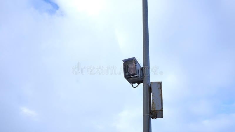 The video surveillance system of traffic regulations on the road against the winter sky stock photo